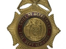 Gold-toned badge owned by chief for the division from 1955-1958.