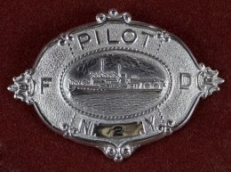Pilot's limit product (cap badge).